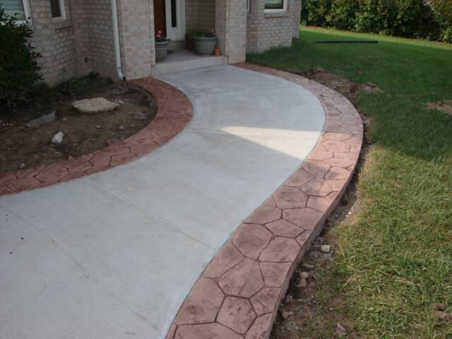 curved sidewalk with stamped ribbons